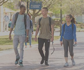 Three students casually walking across CSU's campus.