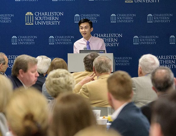 A students speaks at a podium to the CSU Board of Visitors.
