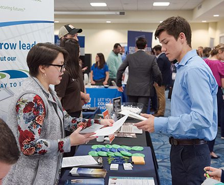 A student and employer exchanging information at the CSU career fair.