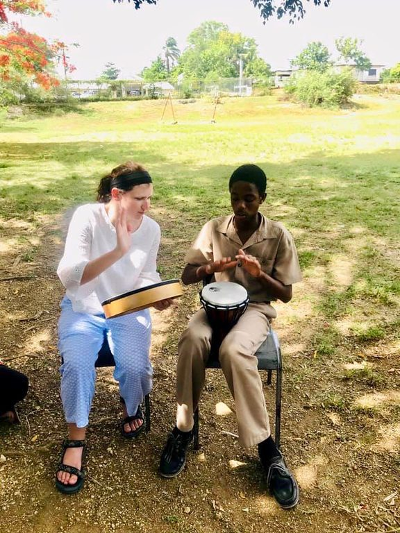 Melinda Gorsky works with a client in Jamaica.
