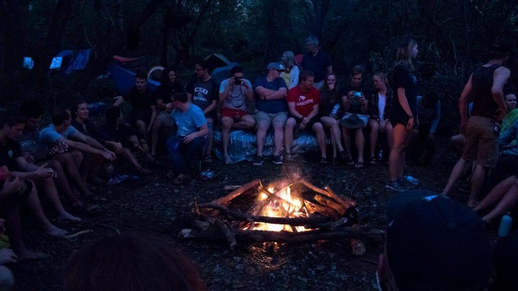 The CSU Outdoor Adventure Club camps out by a fire