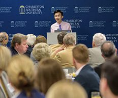 A student speaking at a Board of Visitors meeting