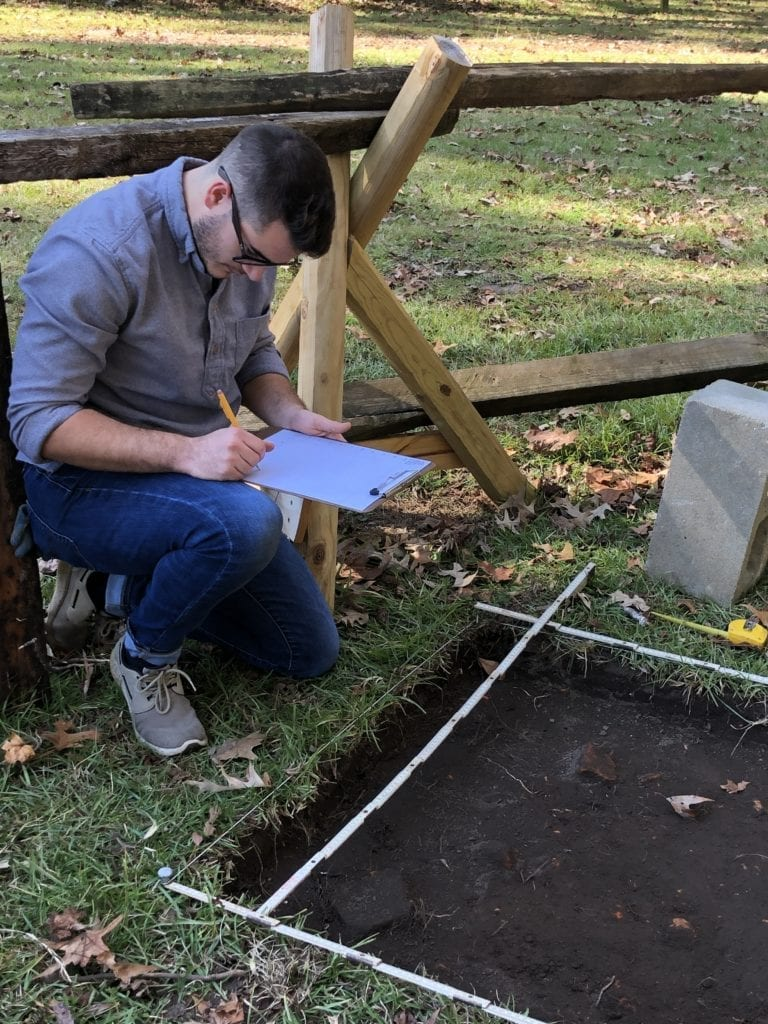 Ethan Shuler, junior at Charleston Southern University, documents the layout of a new dig site