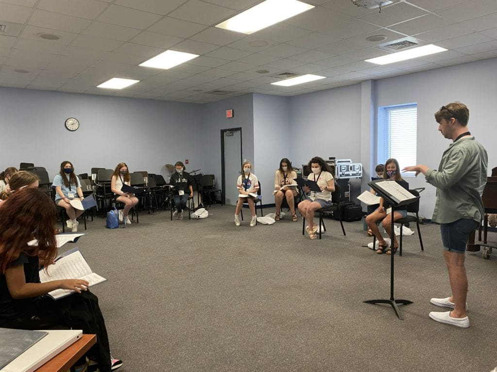 Singers, brass, and woodwind performers were distanced at six feet or more during rehearsals, with frequent breaks for air exchange. String and piano performers wore masks during rehearsals and other indoor activities at Charleston Southern