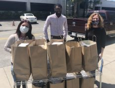 Kevin Jacques and Valerie Sessions delivering meals at the VA hospital