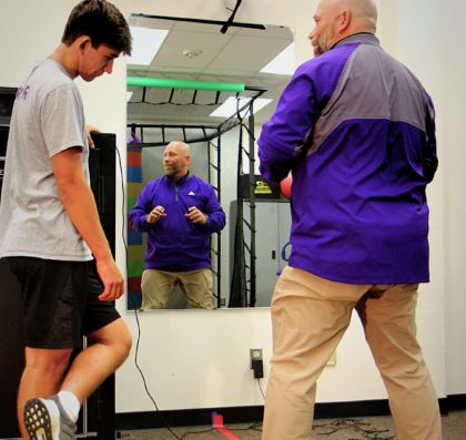 Professor Gerald Larson instructing a Kinesiology student in the lab