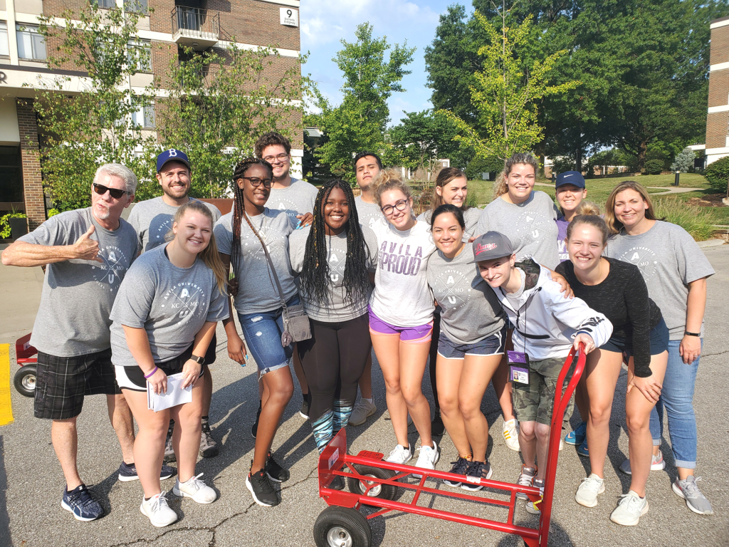 Group of 15 students and administrators posing during Move In day