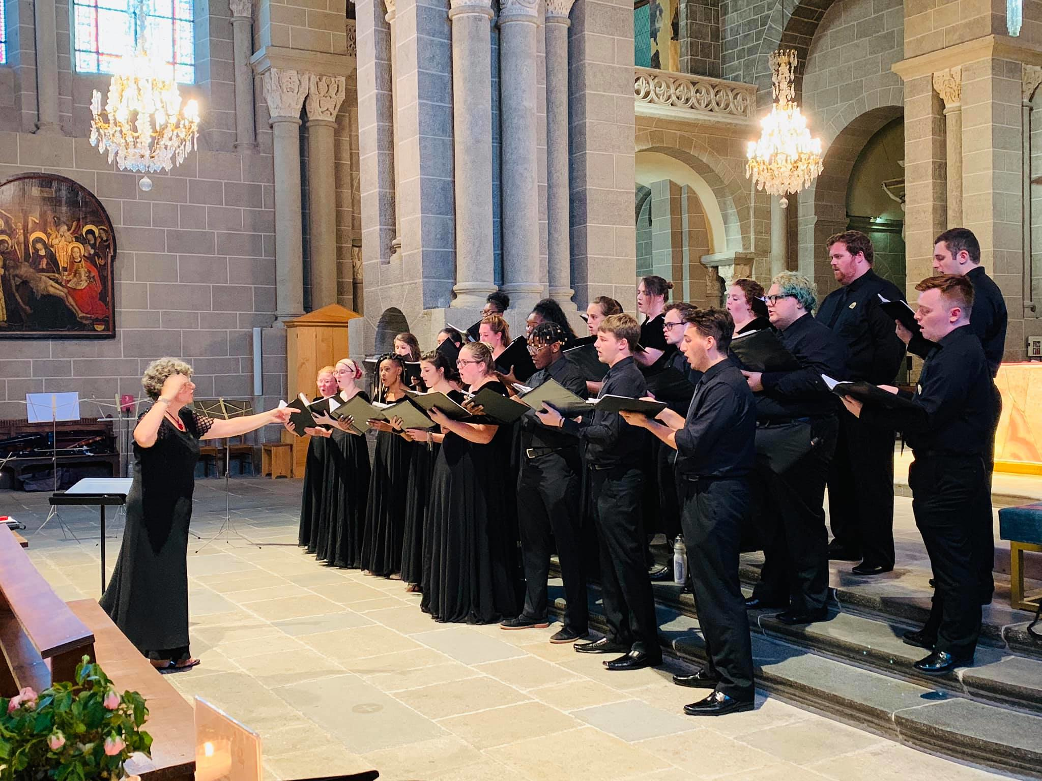 Choir performs in a church space.