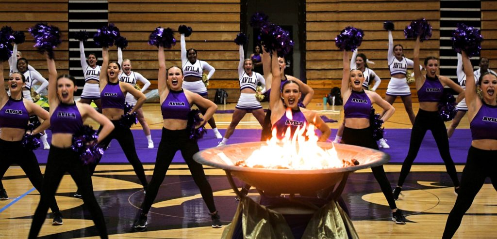 Cheer and Dance teams performing inside Mabee Fieldhouse