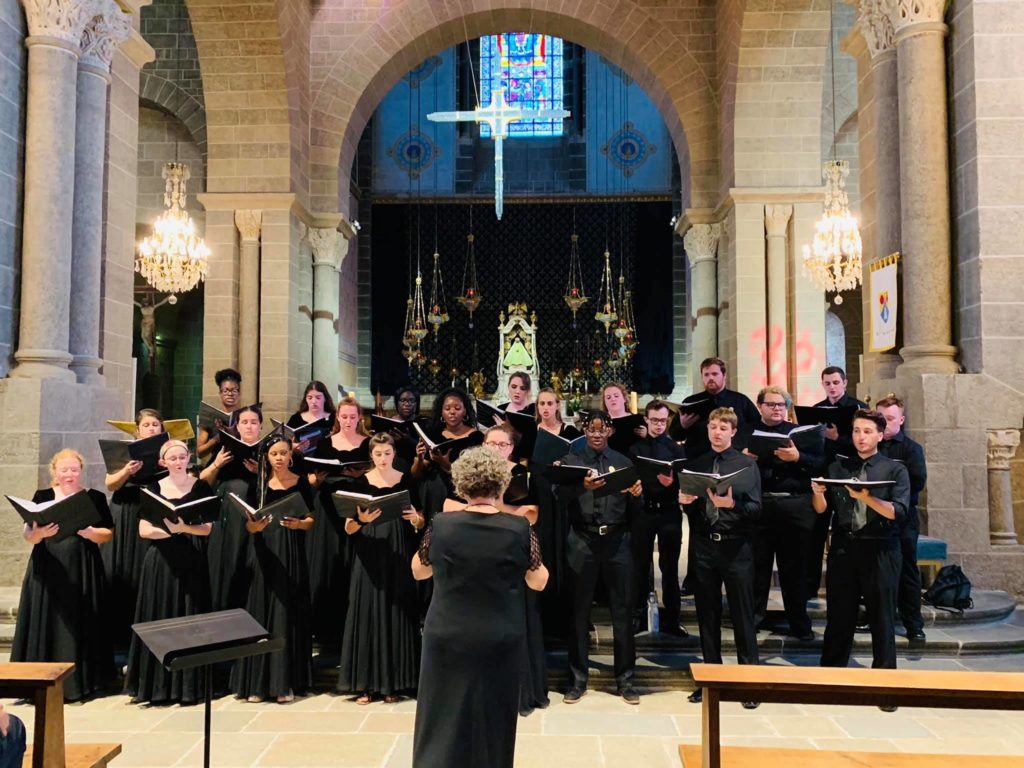 The Avila University Singers perform inside a church in France