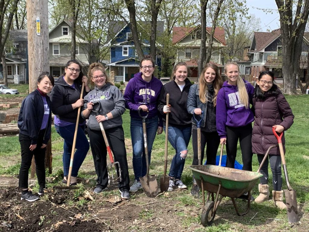 Group of students gardening during Dear Neighbor Day