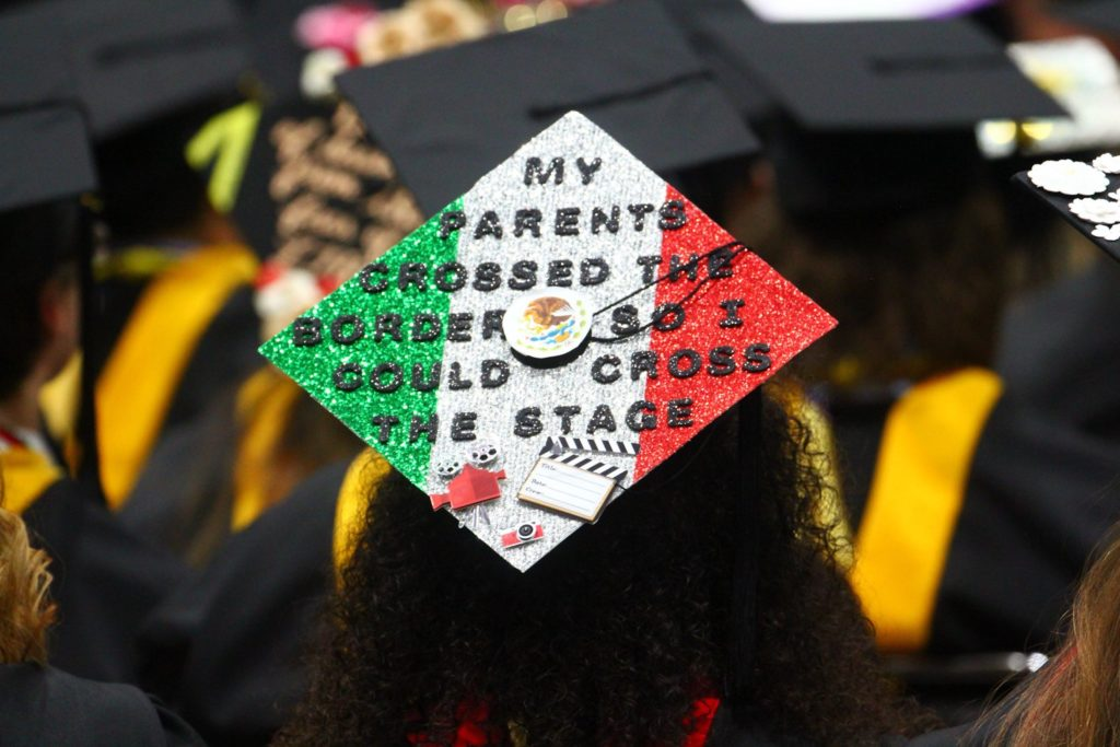 "Graduation cap decoration reads, ""My parents crossed the border so I could cross the stage."""