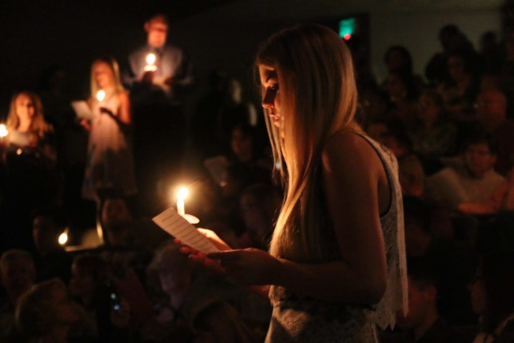 Nursing students read in unison during the candlelight portion of their pinning ceremony