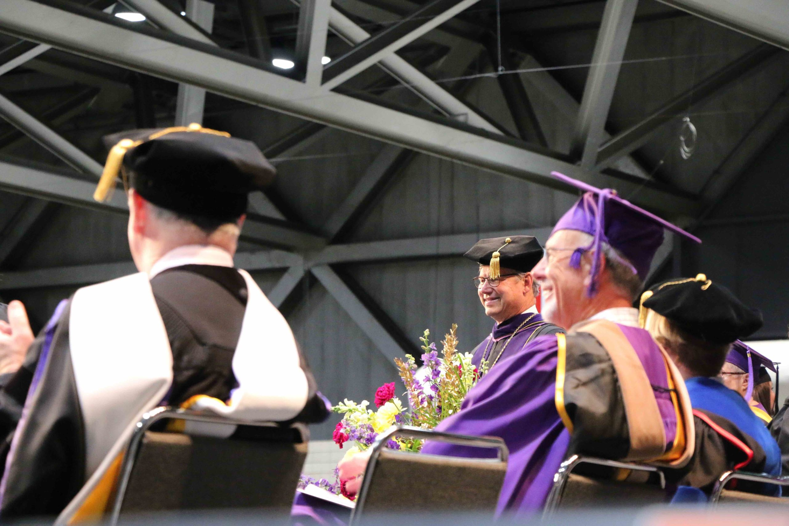 President Ronald Slepitza smiles on the commencement stage
