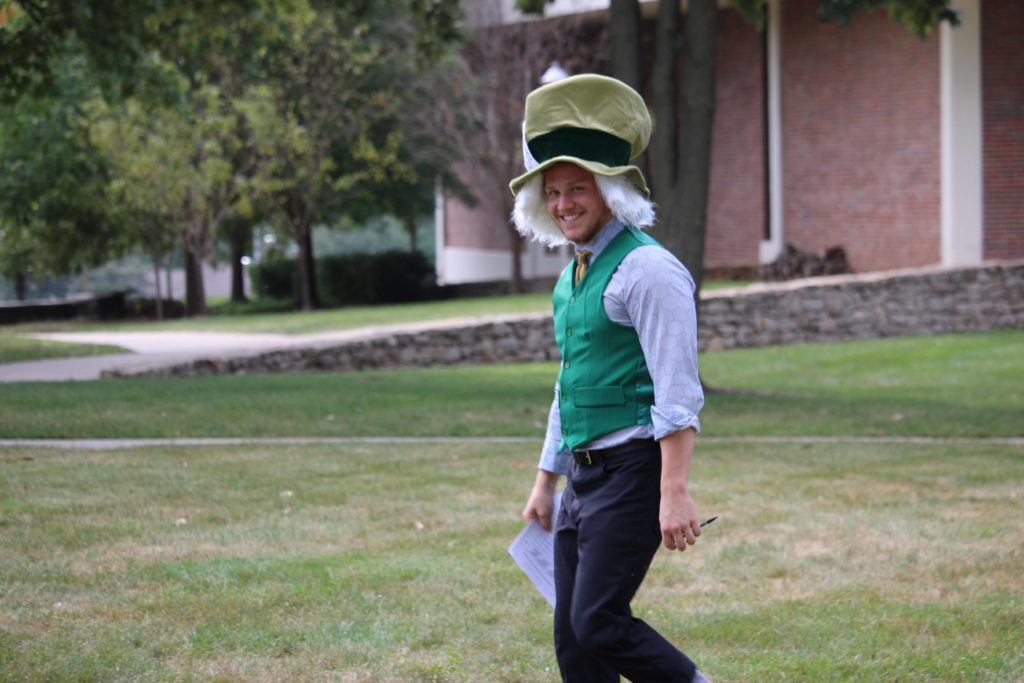 A theatre student walks the campus dressed as the Mad Hatter from Alice in Wonderland