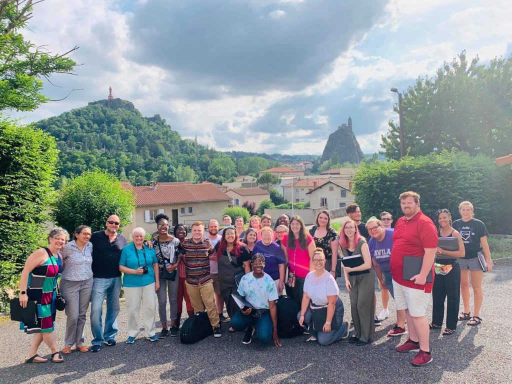 Group photo of Avila choir members in LePuy, France