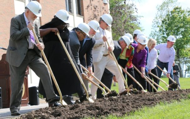 University Staff Break Ground in Front of Goppert Theatre