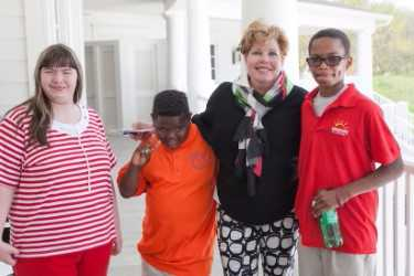 Jeanne Patterson poses with children