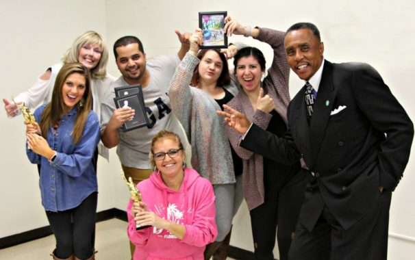 VisCom students and staff pose with awards