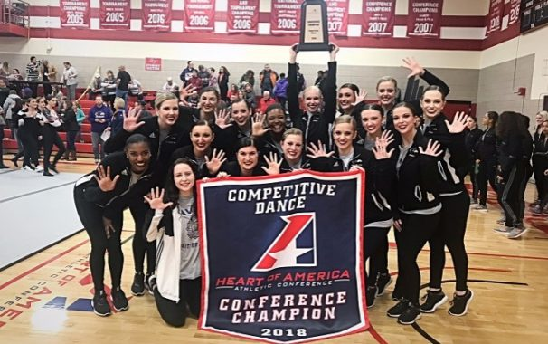 Avila Dance team poses with championship banner