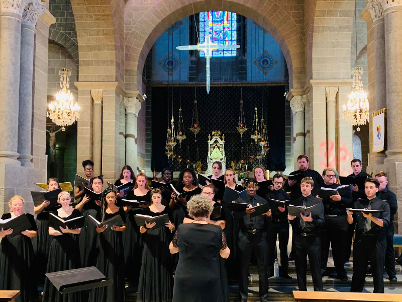 Choral singers performing in an older church