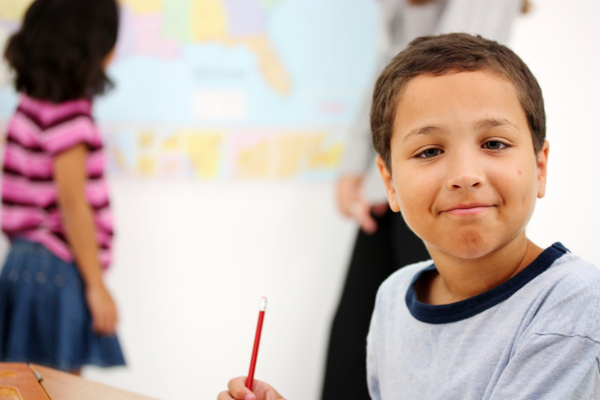 Elementary age student smiling at camera