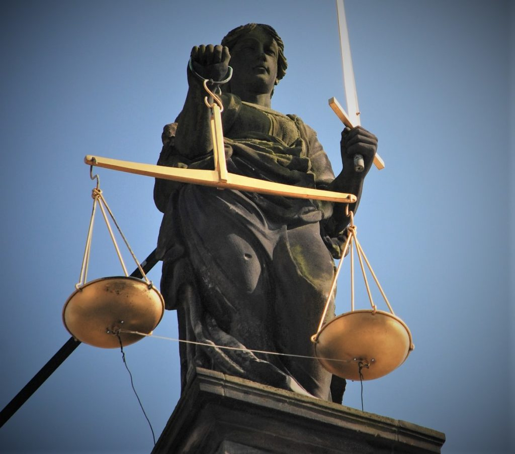 Statue of lady justice is representative of criminology and justice studies.