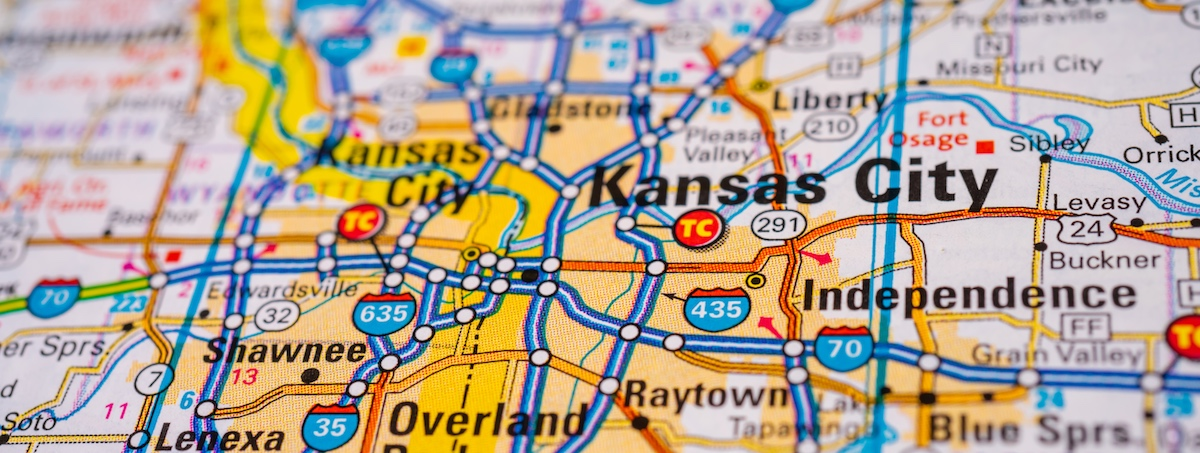 Close up of paper road map showing major highways around the Kansas City metro