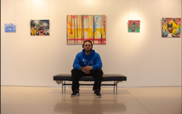 Artist Ryan S. Williams sits inside the Thornhill Art Gallery displaying five of his projects.
