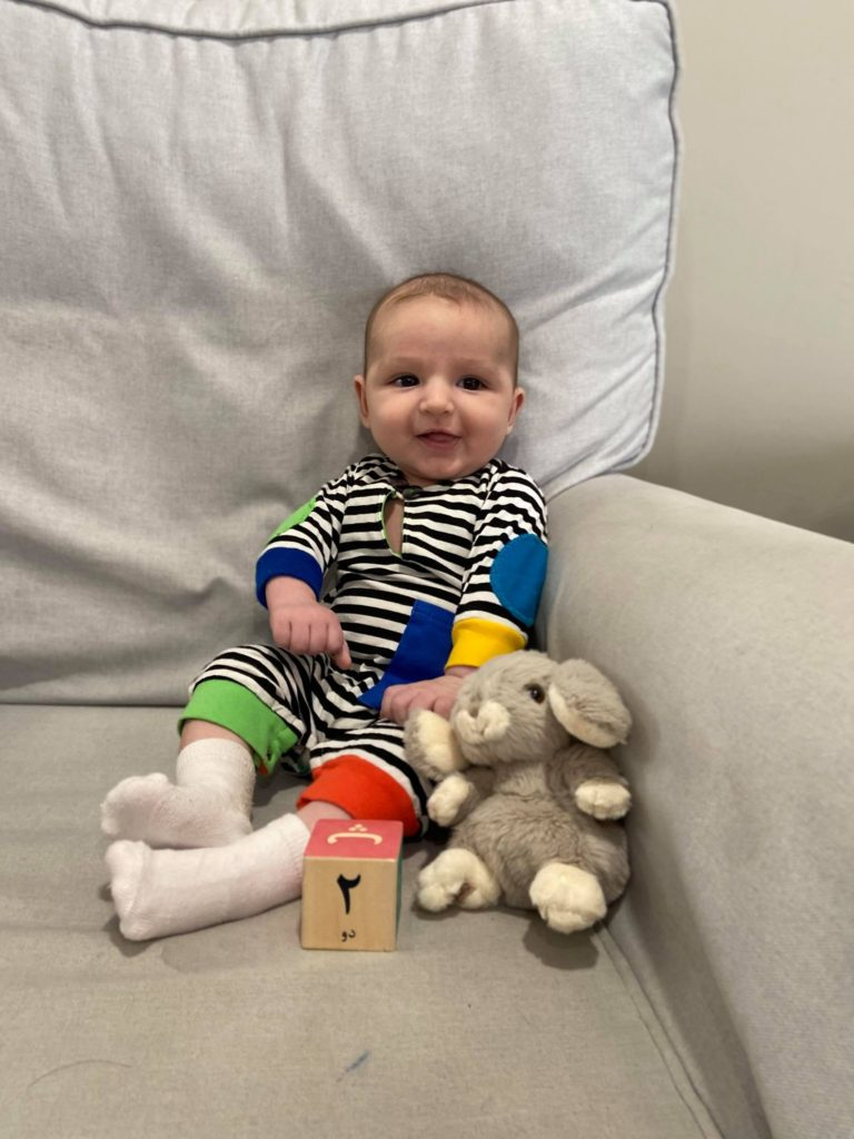 Photo of baby in striped outfit