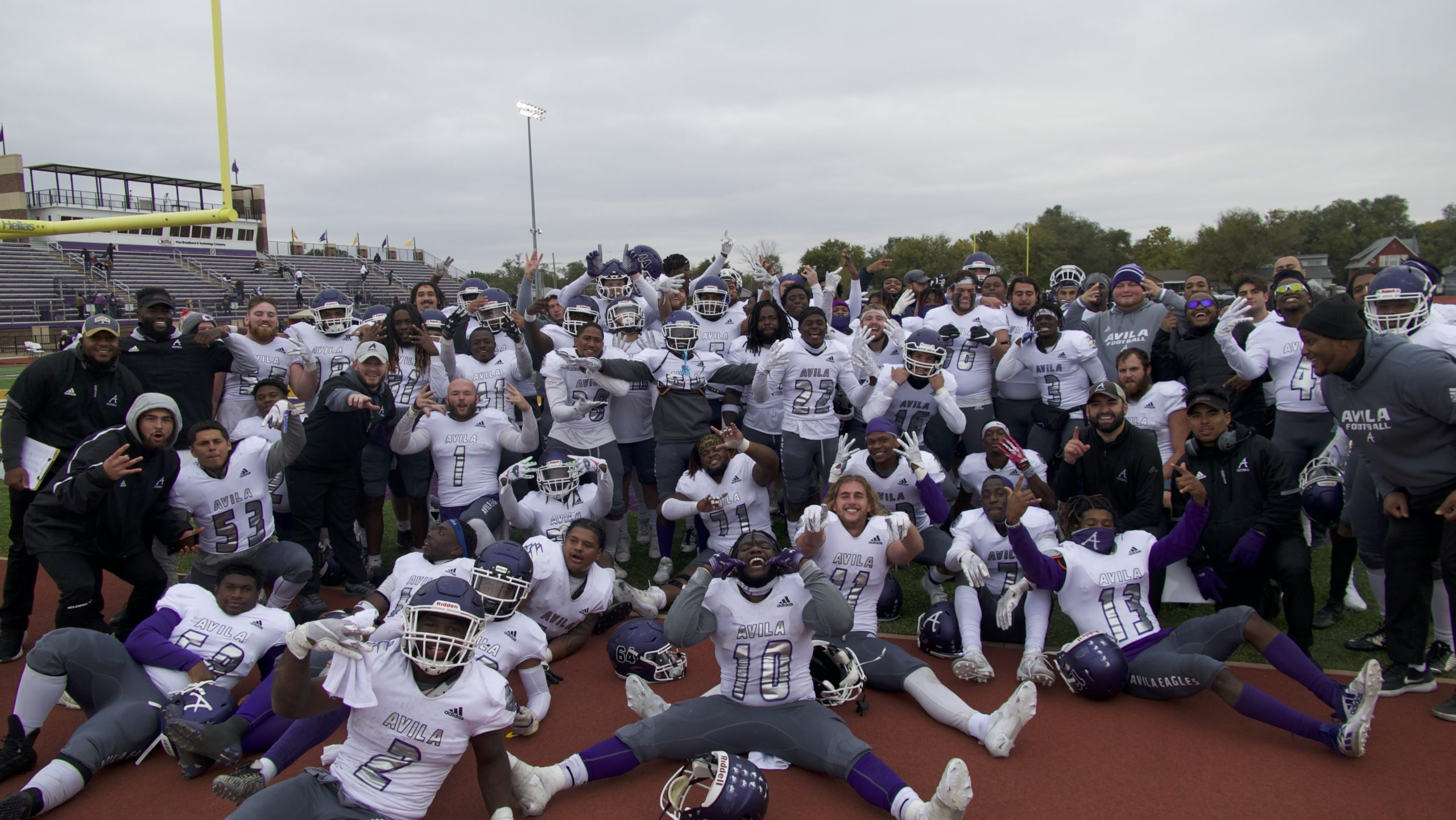 Image of Avila football team celebrating on field after game