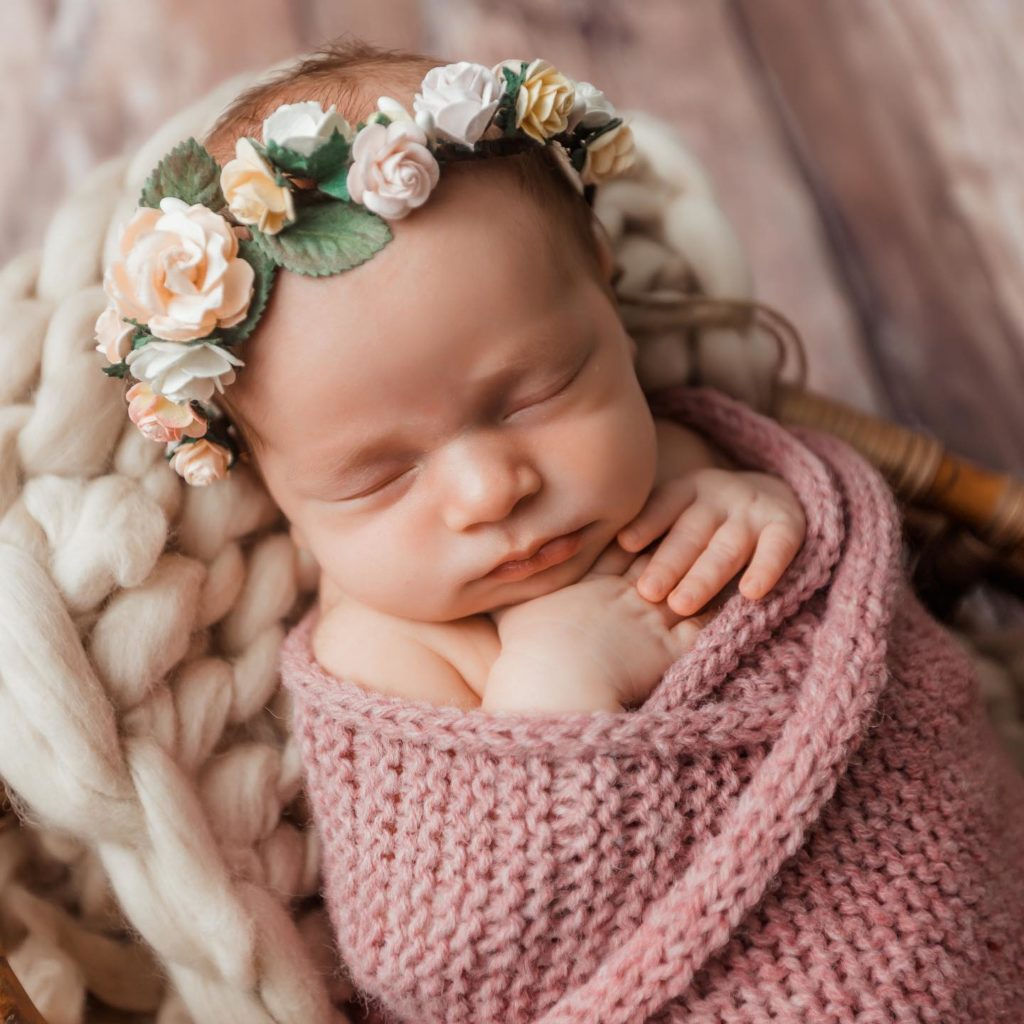 Photo of baby in rose crown