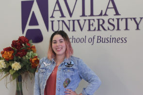 Posed photo of Kristina Noble in front of Avila University School of Business sign