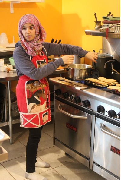 woman at a restaurant style stove