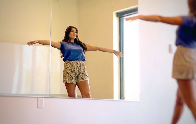 Lone dancer rehearsing in front of mirror