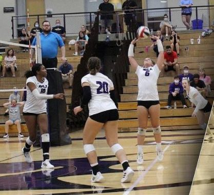 Eagles volleyball team setting a play on the court