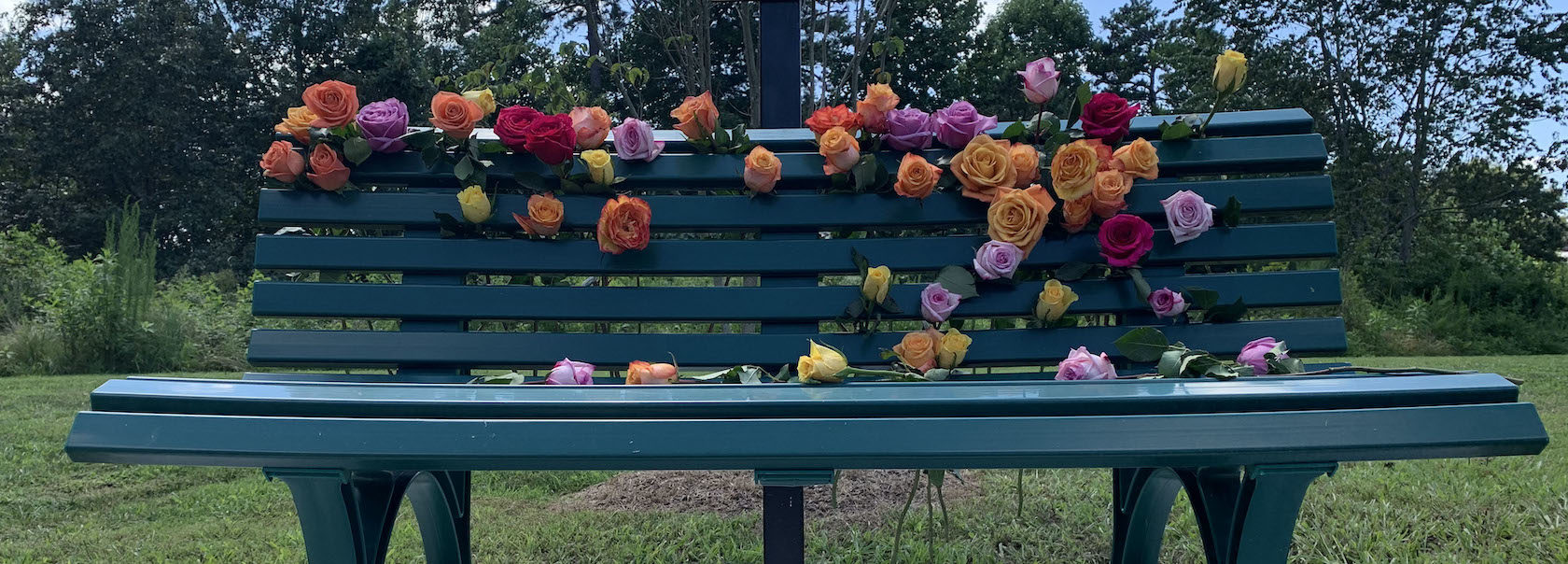 Bench covered with flowers