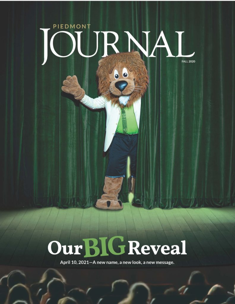 Cover of the Journal magazine with mascot on stage